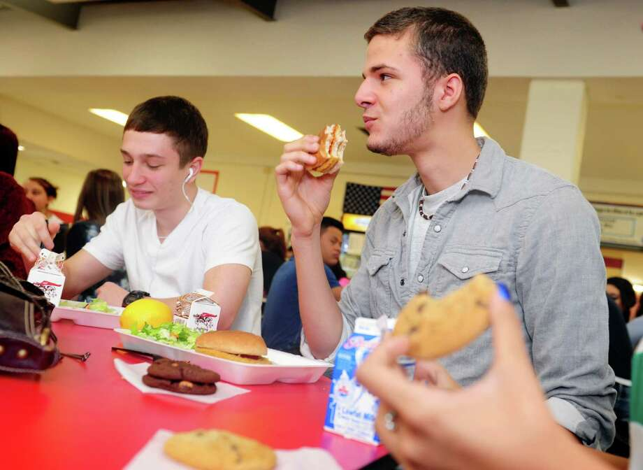 Derby High School junior Josh Rodriguez eats his lunch Wednesday, Oct. 24, 2012 in the school cafeteria.  Rodriguez and other Derby High and Middle School students can now make informed food choices at lunch since the schools became the first on the east coast to institute the NuVal food scoring system in their cafeterias. This is a program that assigns a score (from 1-100) to various food items based on nutritional value. Photo: Autumn Driscoll