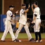 Giants' Marco Scutaro, Angel Pagan and Brandon Belt celebrate their victory, as the San Francisco Giants beat the Detroit Tigers 2-0 in game two of the World Series, on Wednesday Oct. 24, 2012 at AT&T Park, in  San Francisco, Calif.