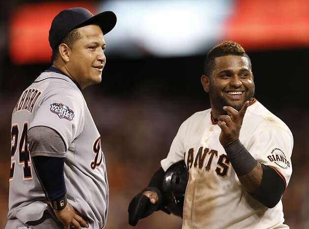 Two of Venezuela's favorite sons, Miguel Cabrera (left) and Pablo Sandoval, share a laugh. Photo: Michael Macor, The Chronicle