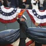 A member of the U.S. Armed Forces waves a rally towel while carrying the flag during pre-game ceremonies prior to the World Series game 2 at AT&T Park in San Francisco, Calif., on Thursday, Oct. 25, 2012.
