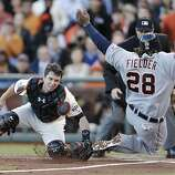 Giants' catcher Buster Posey makes the play at home against Tigers' first baseman Prince Fielder  in the 2nd inning during game 2 of the World Series at AT&T Park on Thursday, Oct. 25, 2012 in San Francisco, Calif.