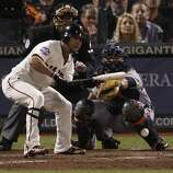 Giants' left fielder Gregor Blanco bunts in the 7th inning during the World Series game 2 at AT&T Park in San Francisco, Calif., on Thursday, Oct. 25, 2012.