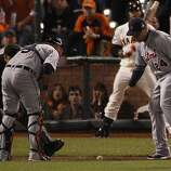 Tigers' catcher Gerald Laird and Tigers' third baseman Miguel Cabrera watch Grego Blanco's slow rolling ball in the 7th inning during the World Series game 2 at AT&T Park in San Francisco, Calif., on Thursday, Oct. 25, 2012.