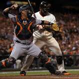Detroit Tigers catcher throws to second base on a stolen base by San Francisco Giants Angel Pagan in the 8th inning of game two of the World Series Thursday, October 25, 2012 in San Francisco, California. Giants won 2-0