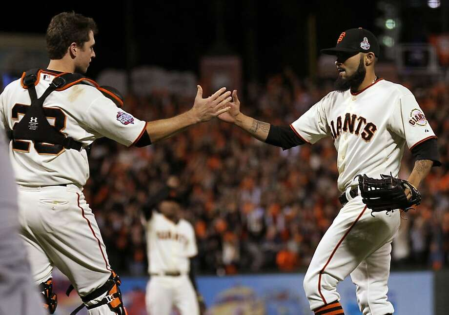 As Buster Posey and Sergio Romo celebrate a 2-0 lead over the Tigers in the World Series, the Giants are surpassing their historical rivals, the Dodgers. Photo: Lance Iversen, The Chronicle