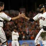 San Francisco Giants catcher Buster Posey and pitcher Sergio Romo celebrate their 2-0 win over the Detroit Tigers in game two of the World Series Thursday, October 25, 2012 in San Francisco, California.