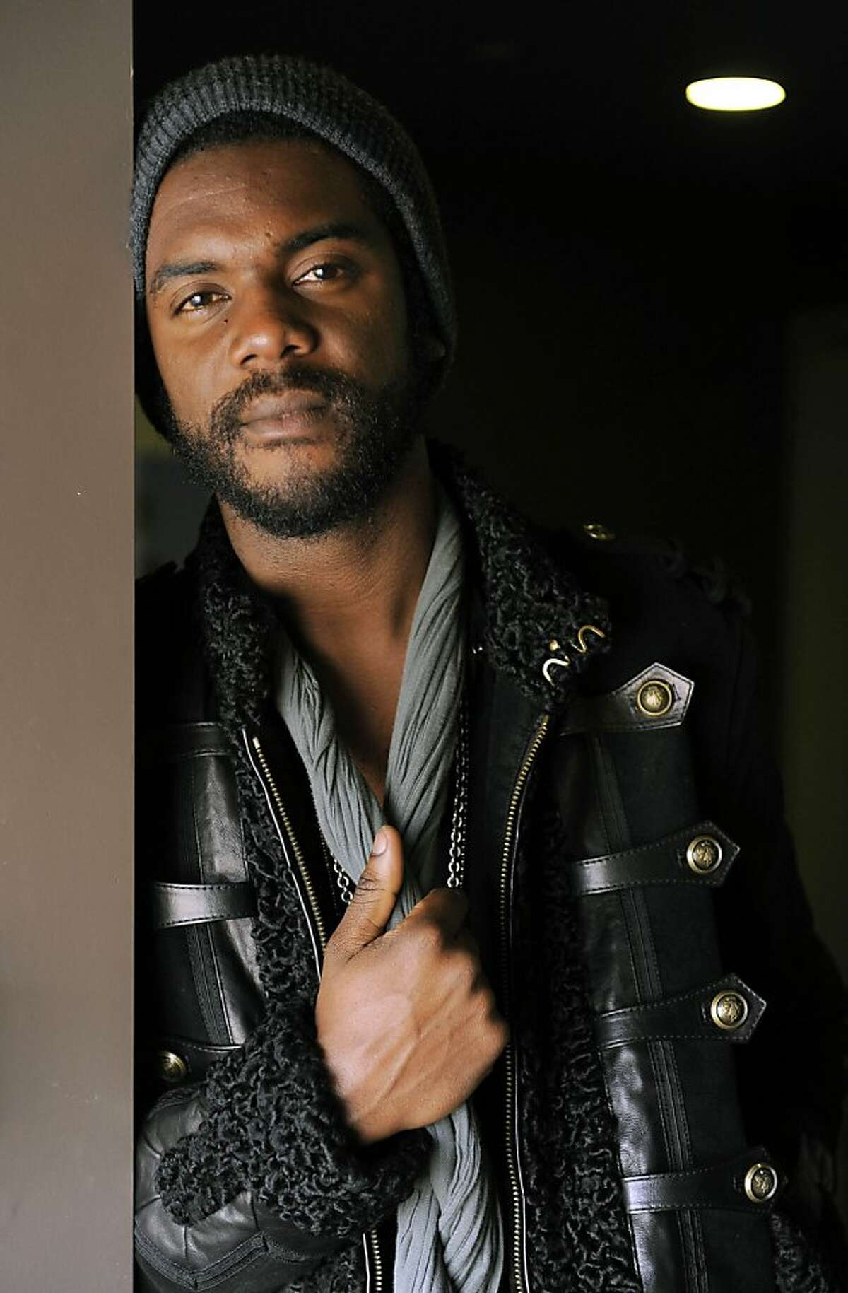 """This Oct. 23, 2012 photo shows guitarist Gary Clark Jr., posing for a portrait at The BLVD Hotel in Los Angeles. Clark's latest album, """"Blak and Blu,"""" was released this week. (Photo by Chris Pizzello/Invision/AP)"""