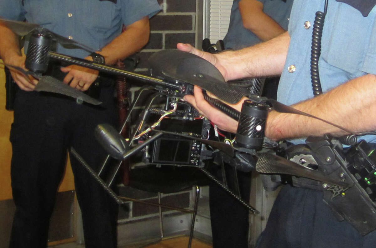 Seattle Police displayed a drone that has the ability to take aerial photos at a maximum of 400 feet. It can run for about 10 minutes. The plan has received mixed reviews, and at an Oct. 25 meeting at the Garfield Community Center several people responded to police by yelling and swearing.