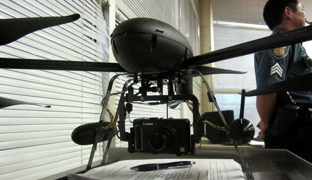 Seattle Police displayed a drone that has the ability to take aerial photos at a maximum of 400 feet. It can run for about 10 minutes. The plan has received mixed reviews, and at an Oct. 25 meeting at the Garfield Community Center several people responded to police by yelling and swearing. Photo: Casey McNerthney/seattlepi.com