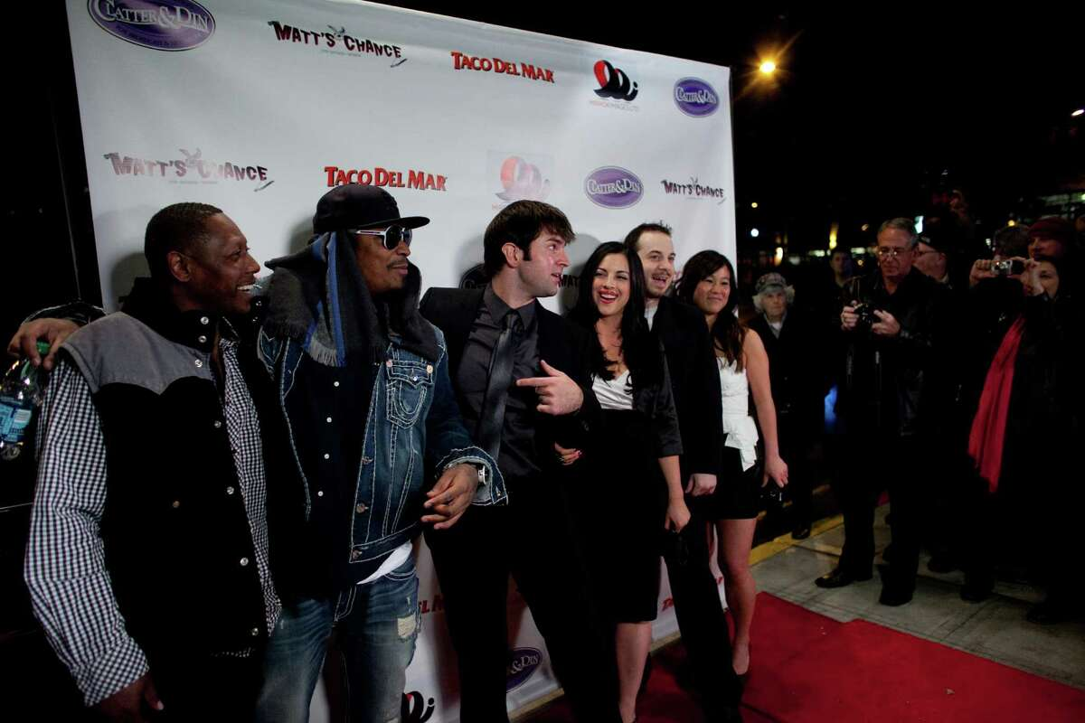 Seattle Seahawk Marshawn Lynch, second from left, and director Nicholas Gyeney, center, pose with others on the red carpet during the premiere of the locally-filmed movie Matt's Chance on Thursday, October 25, 2012 at the Egyptian Theater in Seattle.