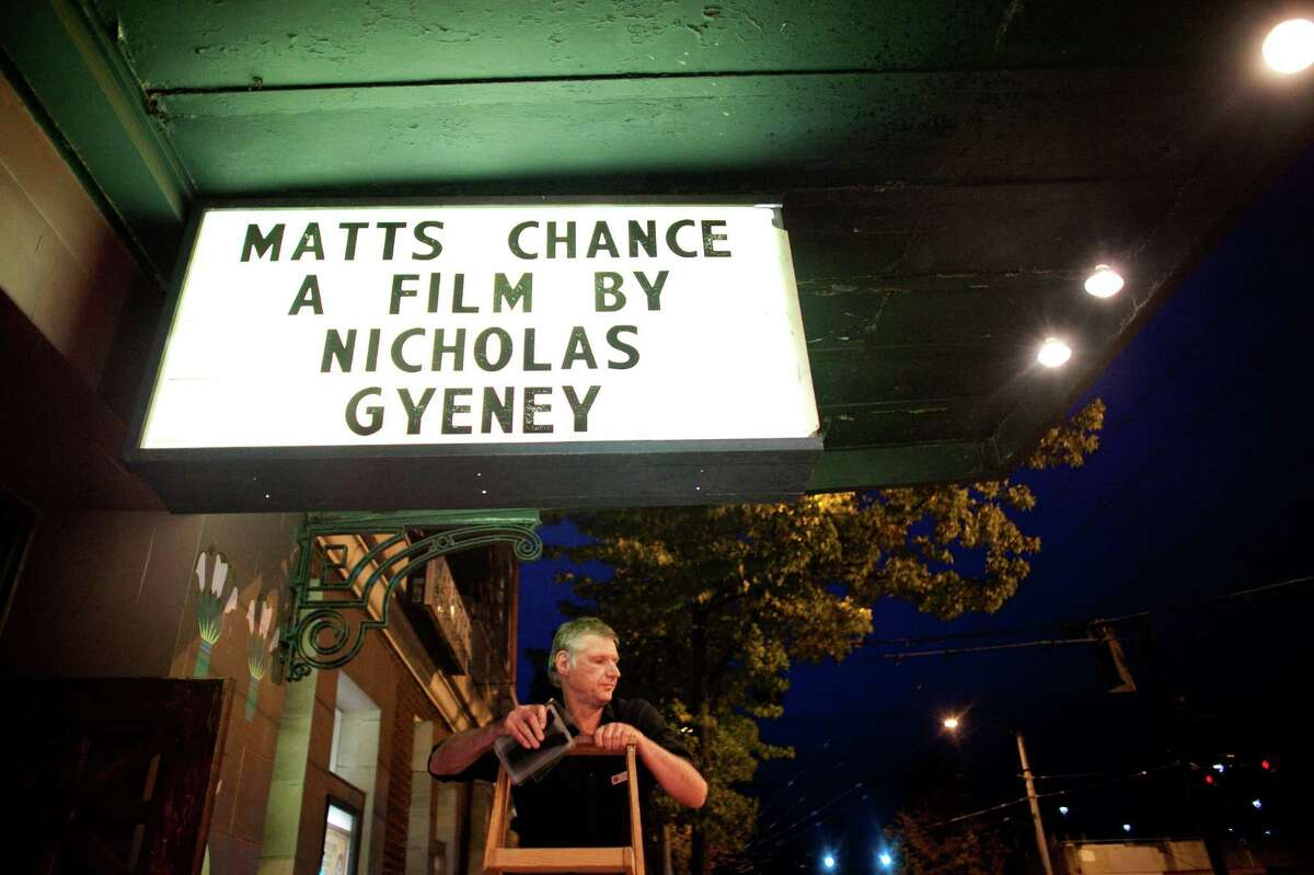 Steve Csutoras of the Egyptian Theater arranges letters on a sign during the premiere of the locally-filmed movie Matt's Chance on Thursday, October 25, 2012 at the Egyptian Theater in Seattle.