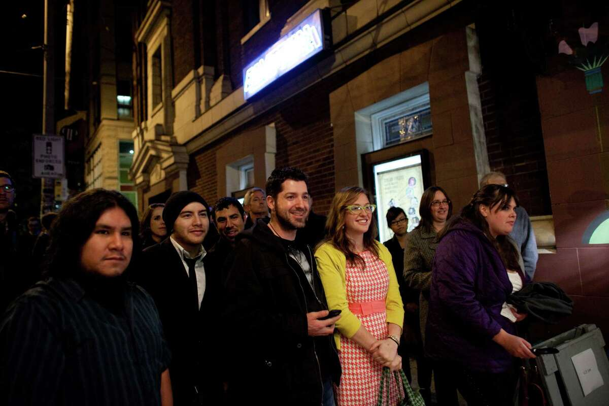 People watch as cast and crew arrive during the premiere of the locally-filmed movie Matt's Chance on Thursday, October 25, 2012 at the Egyptian Theater in Seattle.