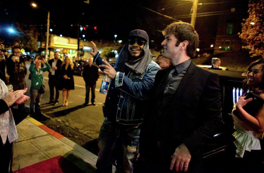 Director Nicholas Gyeney and Seattle Seahawk Marshawn Lynch exit their limo during the premiere of the locally-filmed movie Matt's Chance on Thursday, October 25, 2012 at the Egyptian Theater in Seattle. Photo: JOSHUA TRUJILLO / SEATTLEPI.COM