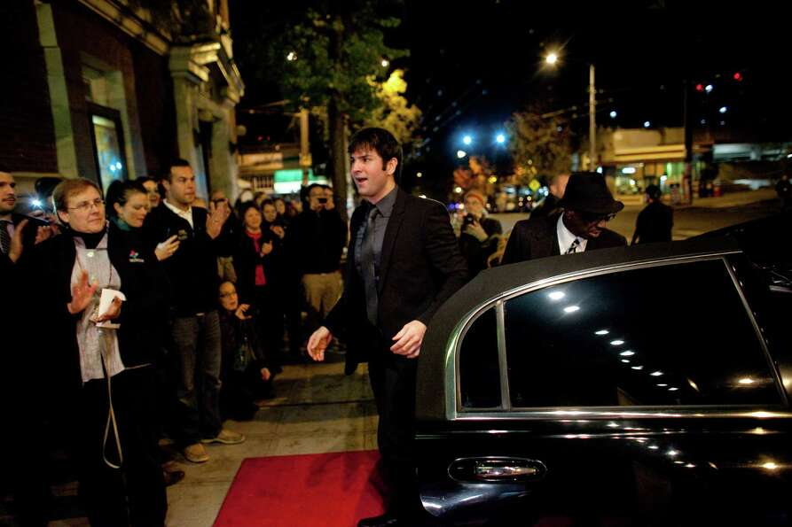 Director Nicholas Gyeney exits his limo during the premiere of the locally-filmed movie Matt's Chanc