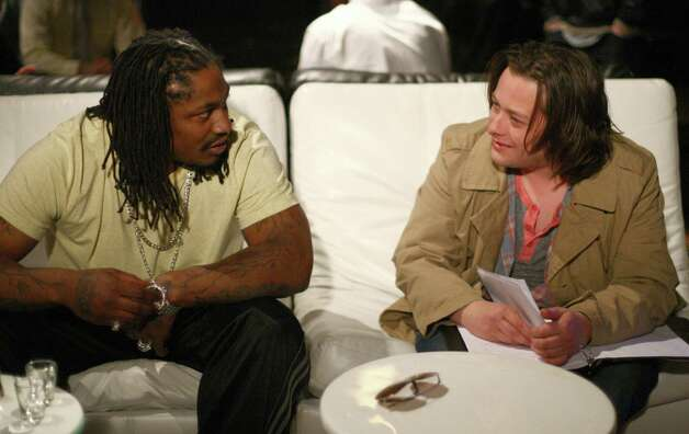 Marshawn Lynch, left,  works with actor Edward Furlong during filming of the dark comedy 'Matt's Chance' on Wednesday, March 28, 2012 at iMusic, a nightclub in downtown Seattle. Photo: JOSHUA TRUJILLO / SEATTLEPI.COM