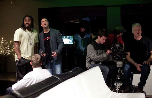 Marshawn Lynch, left, works with director Nicholas Gyeney during filming of the dark comedy 'Matt's Chance' on Wednesday, March 28, 2012, at iMusic in Seattle. Photo: JOSHUA TRUJILLO / SEATTLEPI.COM