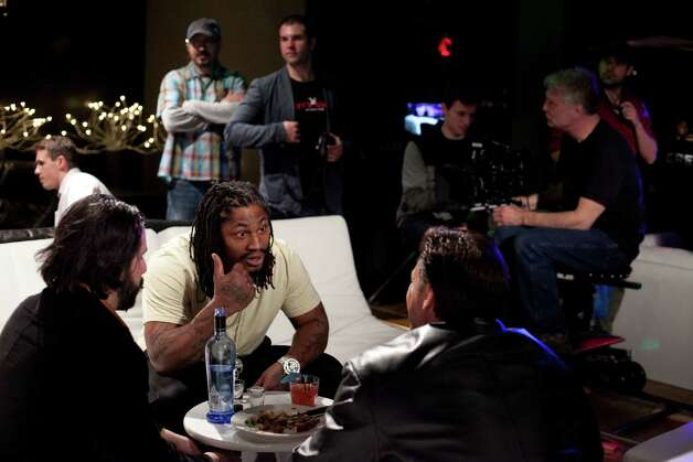 "Marshawn Lynch, center, who plays a bodyguard in the dark comedy 'Matt's Chance,' films a scene on Wednesday, March 28, 2012, at iMusic, a nightclub in downtown Seattle. Gary Busey, Edward Furlong (""Terminator 2"") and Margot Kidder (""Superman"") are also appearing in the film. Photo: JOSHUA TRUJILLO / SEATTLEPI.COM"