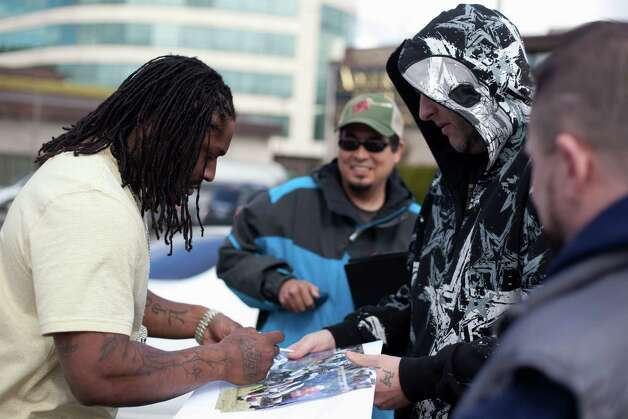 Seahawks running back Marshawn Lynch signs autographs for fans during filming of the dark comedy 'Matt's Chance' on Wednesday, March 28, 2012, at iMusic, a nightclub in downtown Seattle. Photo: JOSHUA TRUJILLO / SEATTLEPI.COM