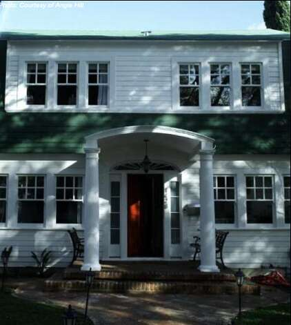 The front still is recognizable but the front door was painted red (Courtesy of Angie Hill/ AOL Real Estate)