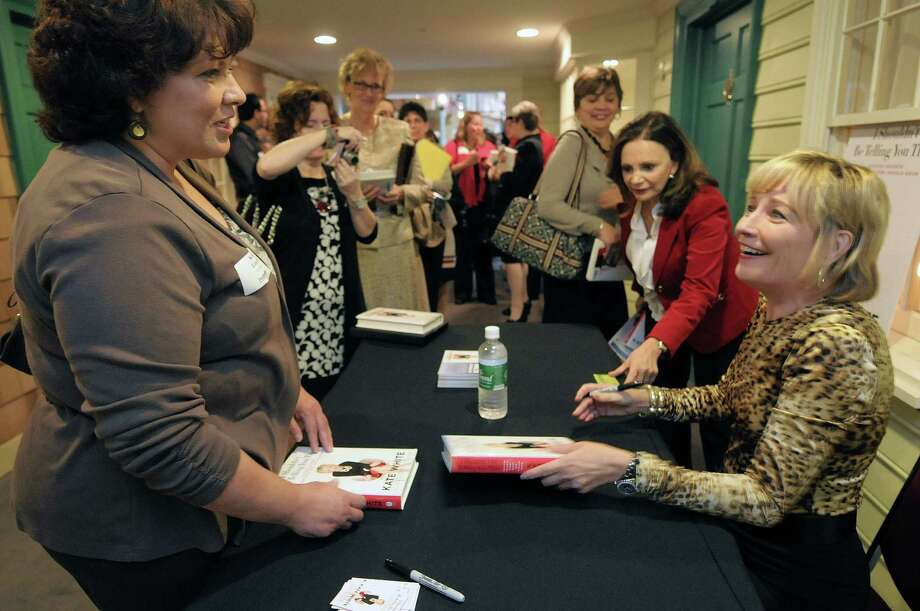 Kathy Lincoln, left, of Ballston Spa talks with  Kate White, author and former editor in chief of Cosmopolitan after White signed two of her book for Lincoln at the Desmond Hotel during a Albany Chamber event  on Thursday, Oct. 25, 2012 in Colonie, NY.  Lincoln was getting the books for her two daughters.  (Paul Buckowski / Times Union) Photo: Paul Buckowski