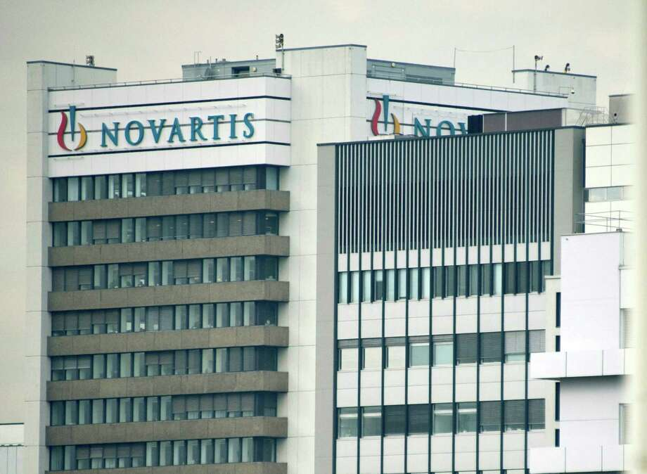 FILE - This Oct. 25, 2011 file photo shows the logo of Swiss pharmaceutical company Novartis AG on one of their buildings in Basel, Switzerland. Novartis AG on Thursday, Oct. 25, 2012, reported a net profit of $2.48 billion during the third quarter, with income remaining flat as new drugs offset patent expirations. The Basel-based company's profits between July and September were virtually unchanged from $2.49 billion in the third quarter of 2011.  (AP Photo/Keystone, Georgios Kefalas, File). Photo: Georgios Kefalas