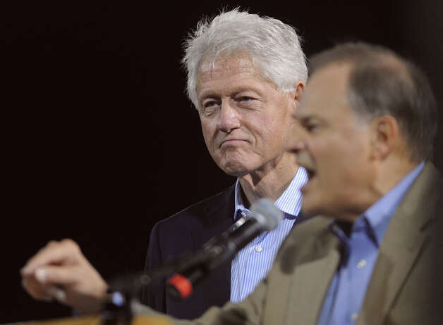 Former President Bill Clinton listens as Nick Lampson encourages Souteast Texans to vote on November 6. The duo both addressed the crowd at Vincent-Beck Stadium on Thursday. Photo taken Thursday, October 25, 2012 Guiseppe Barranco/The Enterprise Photo: Guiseppe Barranco, STAFF PHOTOGRAPHER / The Beaumont Enterprise