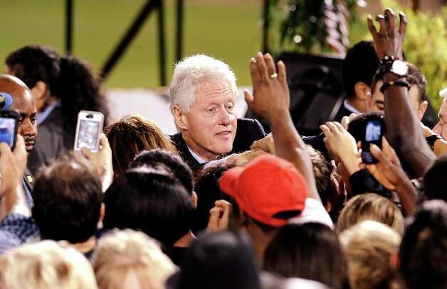 Former President Bill Clinton shakes hands with kind words after Lampsons Get-Out-The-Vote rally to encourage people to vote early at Vincent-Beck Stadium on Thursday, October 25, 2012.   Photo taken: Randy Edwards/The Enterprise Photo: Randy Edwards