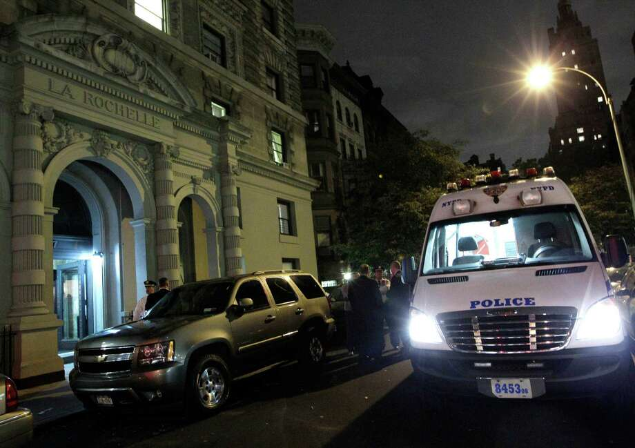 A police crime scene vehicle is parked in front of the luxury Manhattan apartment building where police say a nanny stabbed two small children to death in a bathtub and then stabbed herself in New York, Thursday, Oct. 25, 2012. Police say the children's mother found the scene after returning home with another child. (AP Photo/Kathy Willens) Photo: Kathy Willens, STF / AP