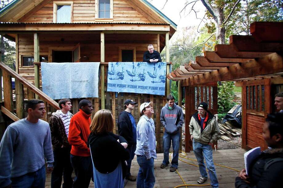 "Phillips gives a tour off his ""Bone House"" to a group of students in a Political Science class from Sam Houston State University Wednesday, Dec. 9, 2009, in Huntsville. 