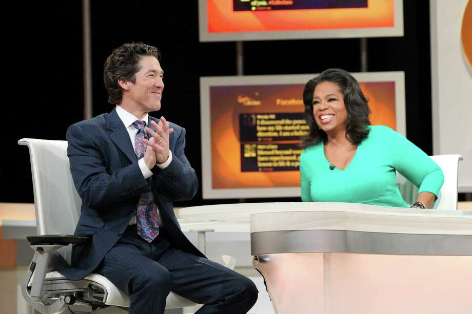 Oprah Winfrey on stage with Lakewood Church Pastor Joel Osteen during Oprah's Lifeclass in Houston, Texas. october 2012 10 5 2012 - LIFECLASS- Houston Texas. A Show - Joel Osteen Photo: George Burns, Chief Photographer