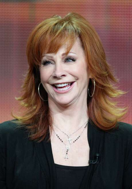 """In """"Malibu Country,"""" Reba McEntire stars as a cheated-on wife of a country star who moves her family to California to begin her own singing career. The sitcom premieres at 7:30 p.m. Saturday on ABC. Photo: Frederick M. Brown, Stringer / 2012 Getty Images"""