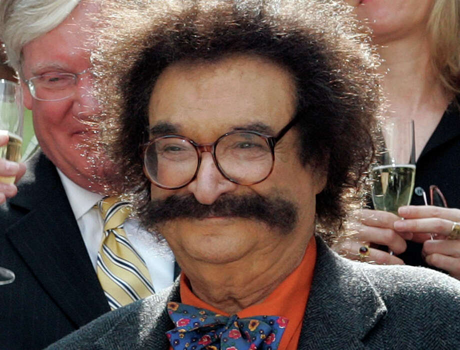 """FILE - In this May 31, 2006 file photo, film critic Gene Shalit is seen during a toast with """"Today"""" show cast and crew at the end of Katie Couric's final show, in New York.  Shalit, 86, faces a charge of driving to endanger after his vehicle struck a utility pole and came to rest against a home in Lenox, Mass., Wednesday, Oct. 24, 2012, according to police.  (AP Photo/Richard Drew, File) Photo: Richard Drew"""