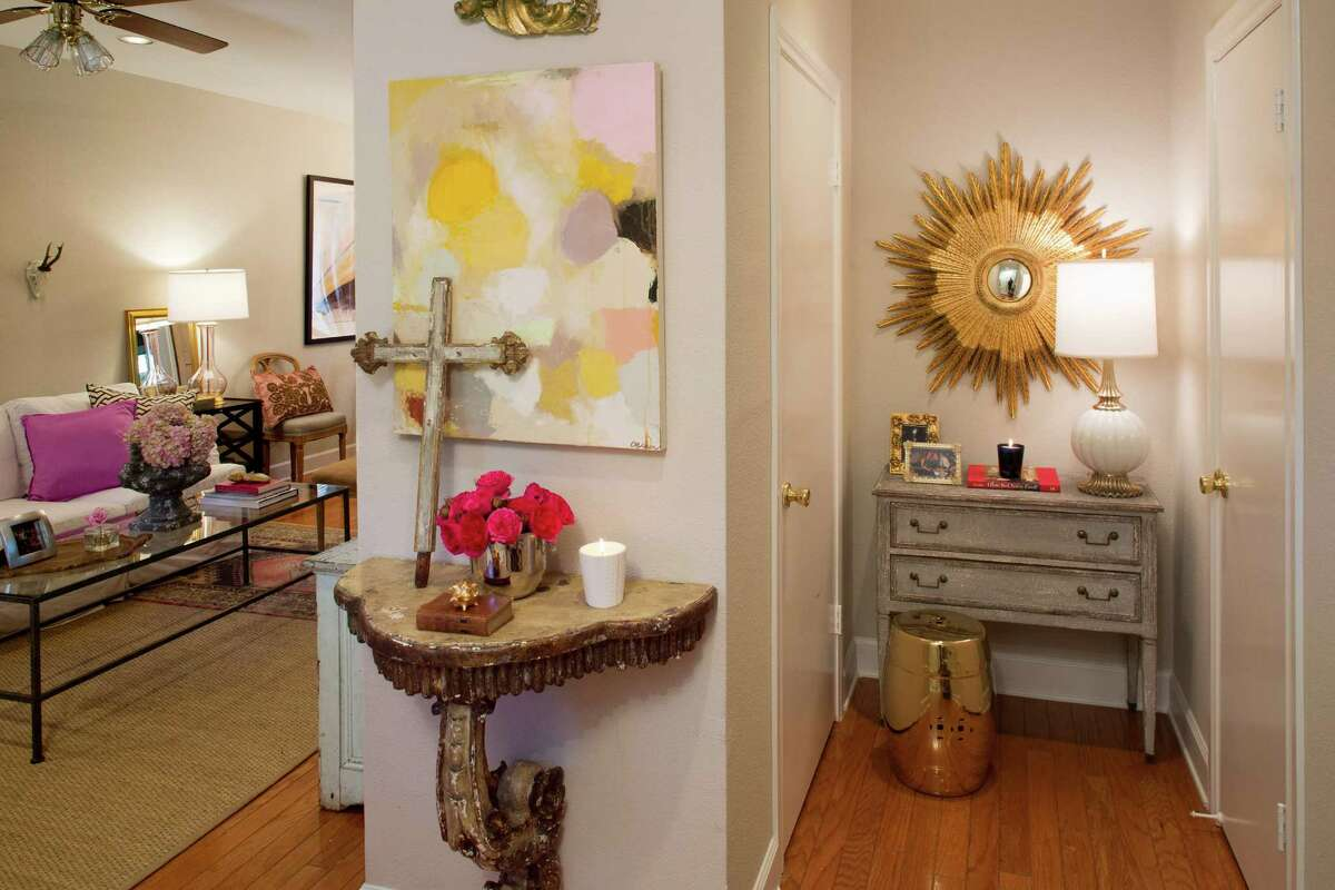 Julie Dodson loves pink, as one can tell from the view from the entryway of her condo.