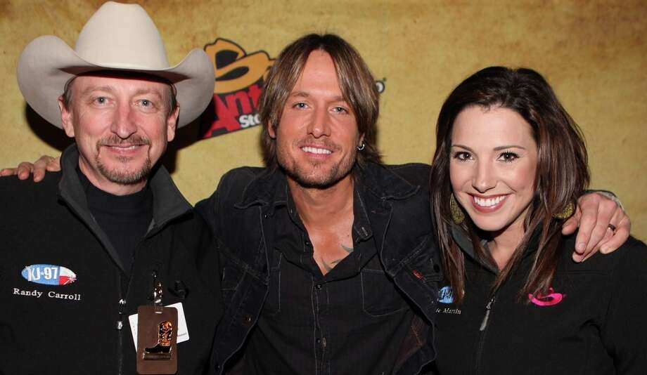 Randy Carroll and Jamie Martin (pictured with country star Keith Urban) have been named the CMA's Broadcast Personality of the Year -- Large Market. Photo: KJ-97