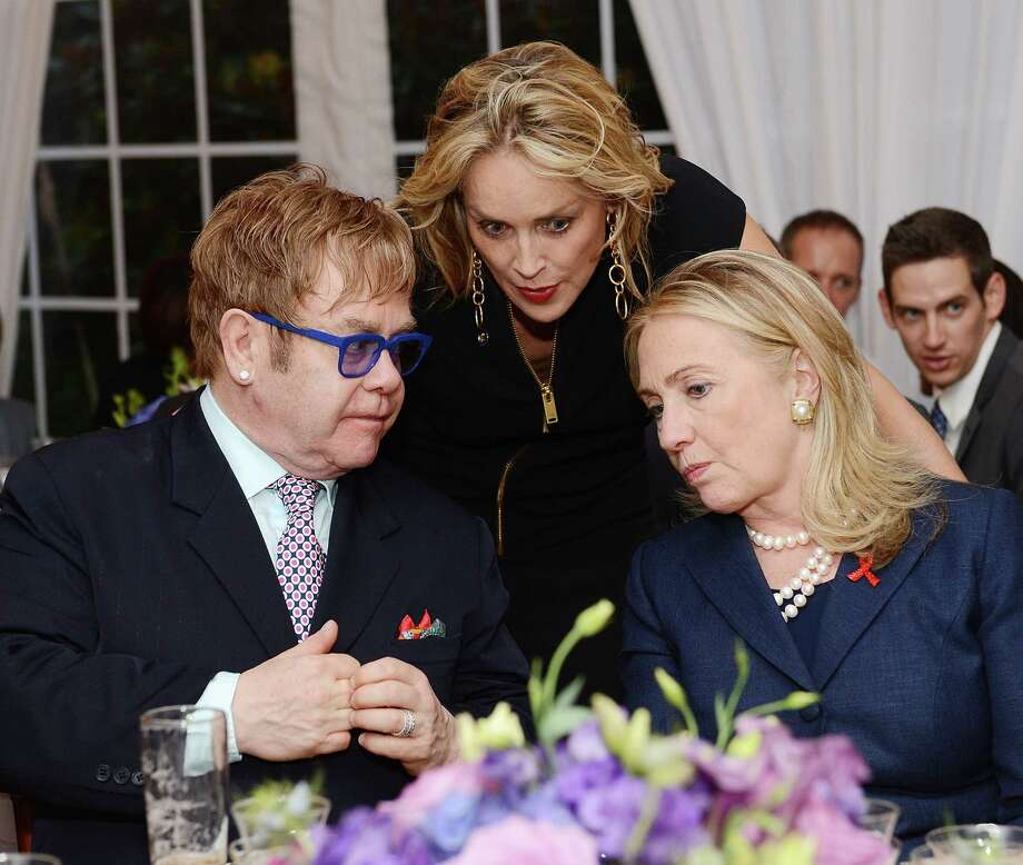 Sir Elton John, actress Sharon Stone, and Secretary of State Hillary Clinton attend The Human Rights Campaign, The Global Equality Fund and The Elton John AIDS Foundation Honor Secretary of State Hillary Clinton and Sir Elton John at a Private Residence on July 23, 2012 in Washington, DC. Photo: Michael Kovac, Getty Images / 2012 Getty Images
