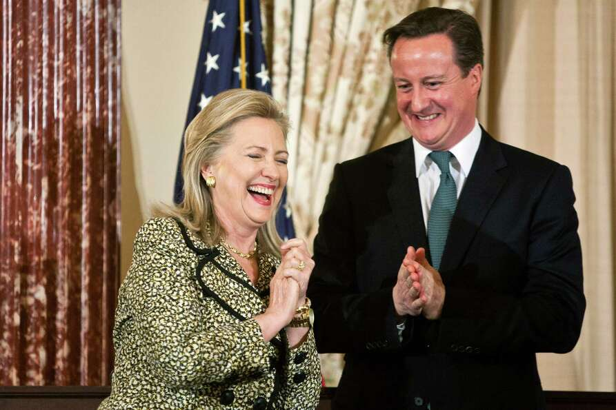 Secretary of State Hillary Clinton and British Prime Minister David Cameron share a laugh during a l