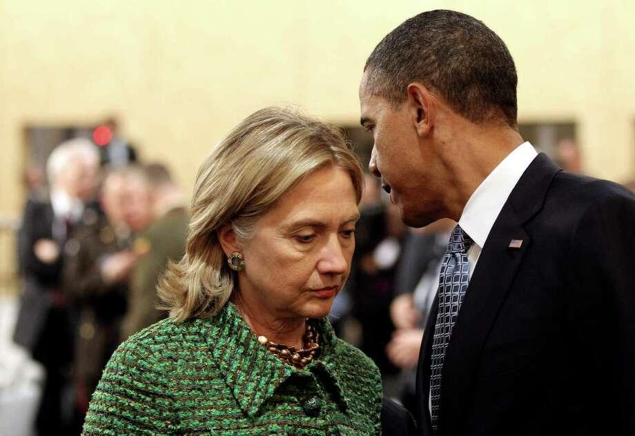 President Barack Obama and Secretary of State Hillary Clinton talk before the North Atlantic Meeting during the NATO Summit 2010 at Feira Internacional de Lisboa on Nov. 19, 2010 in Lisbon, Portugal. Photo: Miguel Villagran, Getty Images / 2010 Getty Images