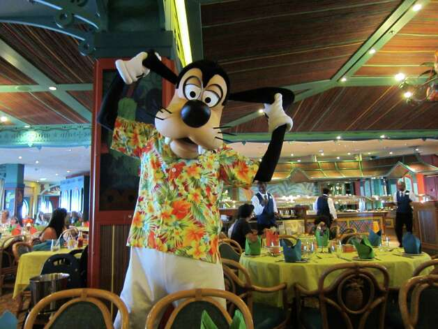 Disney Magic allows adults to be kids again - like at this character breakfast - or to have an adult experience. Photo: Syd Kearney