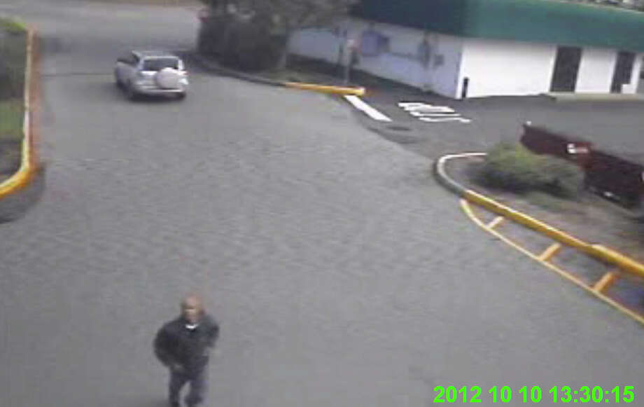 Still photo captured from video surveillance of a suspect wanted in the shooting of a Greenwich woman in the parking lot of a nearby Super Stop & Shop in Norwalk. Police are working with another agency to enhance the footage. Photo: Contributed Photo
