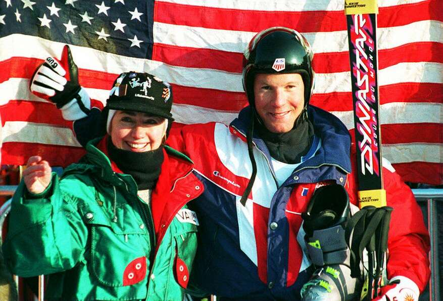First Lady Hillary Clinton and gold medalist of the men's downhill Tommy Moe pose for photographers
