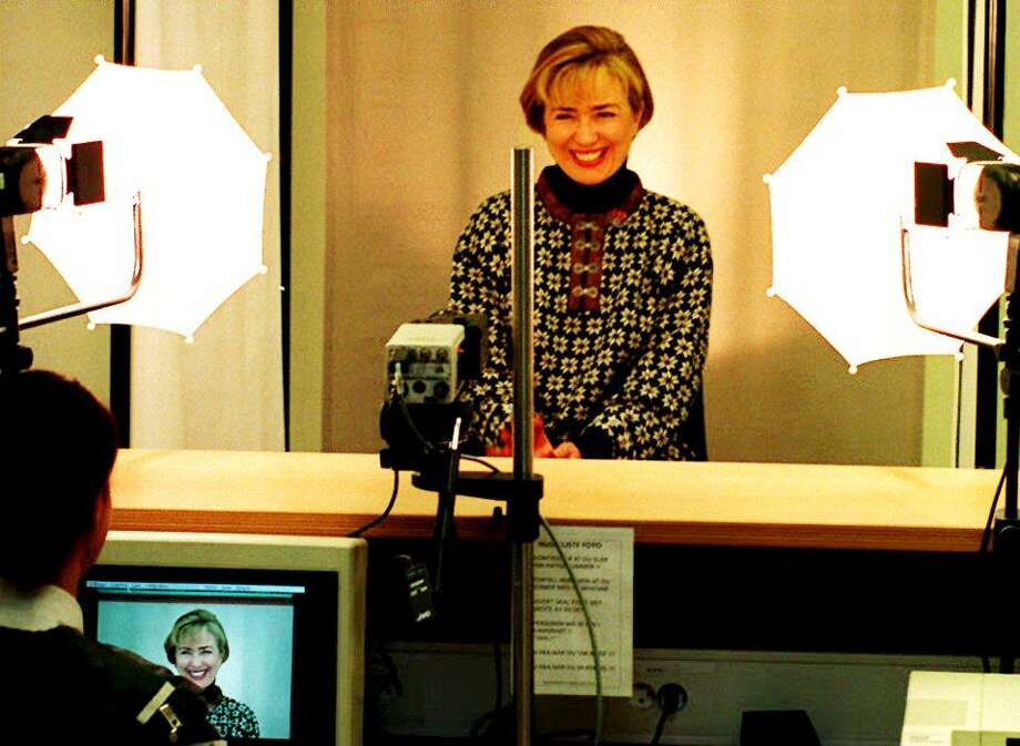 U.S First Lady Hillary Rodham Clinton has her photo taken while doing her credentials to attend the XVII Olympic Winter Games in Lillehammer, Norway on Feb. 12, 1994. Photo: CHRIS WILKINS, Getty Images / AFP