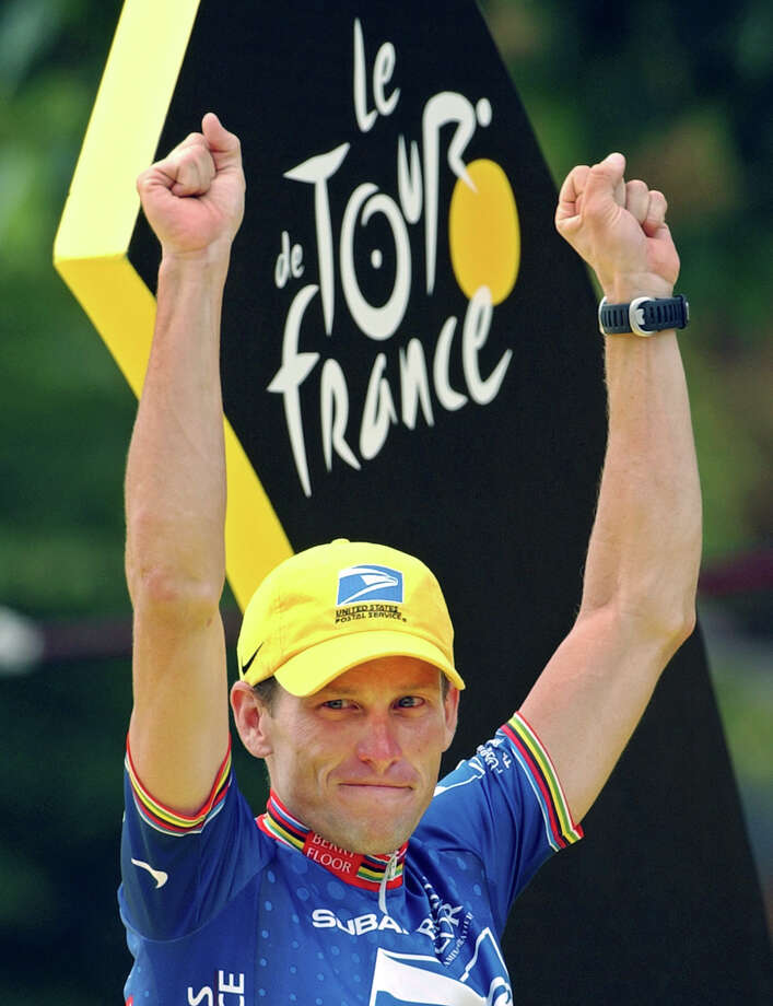 FILE - This July 27, 2003 file photo shows Lance Armstrong waving on the podium after he won his fifth consecutive Tour de France cycling race, in Paris. Armstrong was stripped of his seven Tour de France titles and banned for life by cycling's governing body Monday, Oct. 22, 2012, following a report from the U.S. Anti-Doping Agency that accused him of leading a massive doping program on his teams. UCI President Pat McQuaid announced that the federation accepted the USADA's report on Armstrong and would not appeal to the Court of Arbitration for Sport.  (AP Photo/Peter Dejong, File) Photo: PETER DEJONG, STF / AP