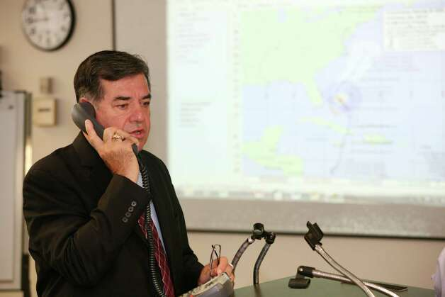 Stamford Mayor Michael Pavia on the phone before the start of a pre storm planning session held at the Government Center in Stamford, Conn. on Friday, Oct. 26, 2012. Photo: David Ames