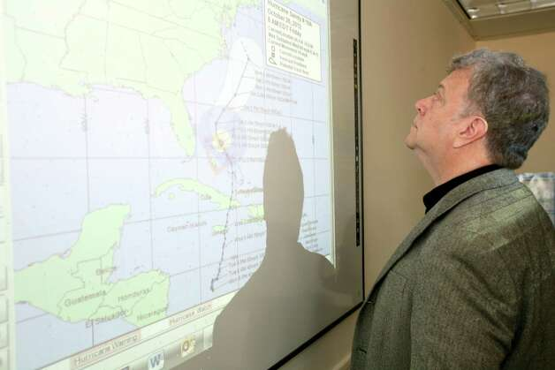Stamford Customer Service Supervisor Frank Fedeli looks at a map with the track of Hurricane Sandy after a storm planning meeting at the Government Center in Stamford, Conn. on Friday, Oct. 26, 2012. Photo: David Ames