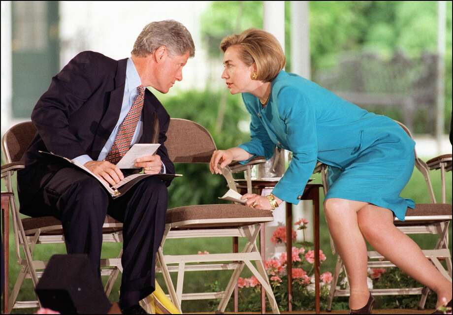 First Lady Hillary Clinton in a picture taken April 29, 1994 in Washington, DC., leans across an empty chair to talk with President Bill Clinton during a meeting with Native Americans on the South Lawn of the White House. Photo: ROBERT GIROUX, Getty Images / AFP