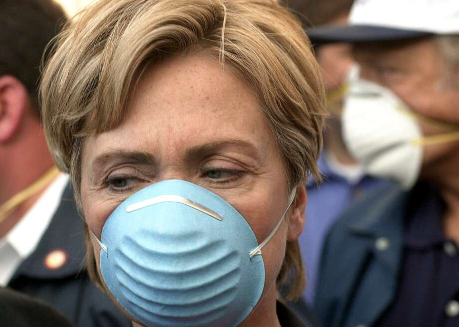 Sen. Hillary Clinton wears a dust mask while touring the site of the World Trade Center attack on Sept. 12, 2001, one day after a terrorist attack destroyed the twin towers. Photo: ROBERT F. BUKATY, Getty Images / AFP