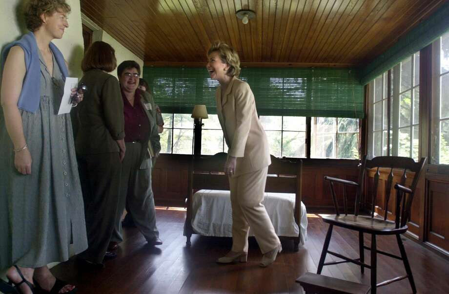 "First Lady Hillary Rodham Clinton laughs with Anne Roosevelt, grand daughter of Eleanor Roosevelt, while touring Eleanor Roosevelt's sleeping porch during a July 17, 2000, visit to the former first lady's Val Kill Cottage in Hyde Park, NY.  The visit is part of the ongoing ""Save America's Treasures"" program, the preservation of historic and threatened landmarks. Photo: BEBETO MATTHEWS, Getty Images / AFP"