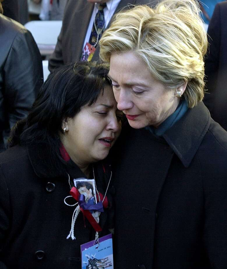 US Senator Hillary Clinton consoles Maren Sarkar on Oct. 28, 2001, after the World Trade Center Family Memorial Service in New York. Several thousand people attended the memorial service near ground zero of the attack. Photo: STAN HONDA, Getty Images / AFP