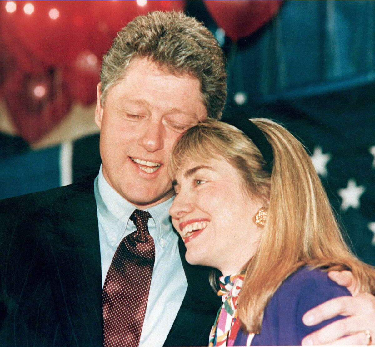 A 1992 photo shows Bill and Hillary Clinton embracing.