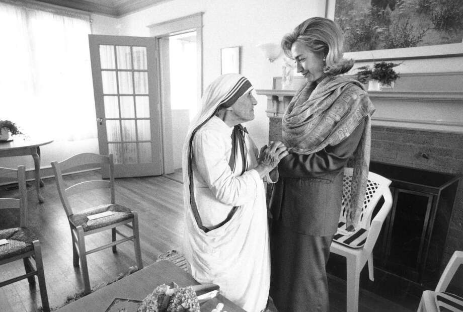 In this June 19, 1995 file photo released by the White House, First Lady Hillary Rodham Clinton meets with Mother Teresa at the opening of the Mother Teresa Home for Infant Children in Washington, D.C. Photo: AFP, Getty Images / AFP